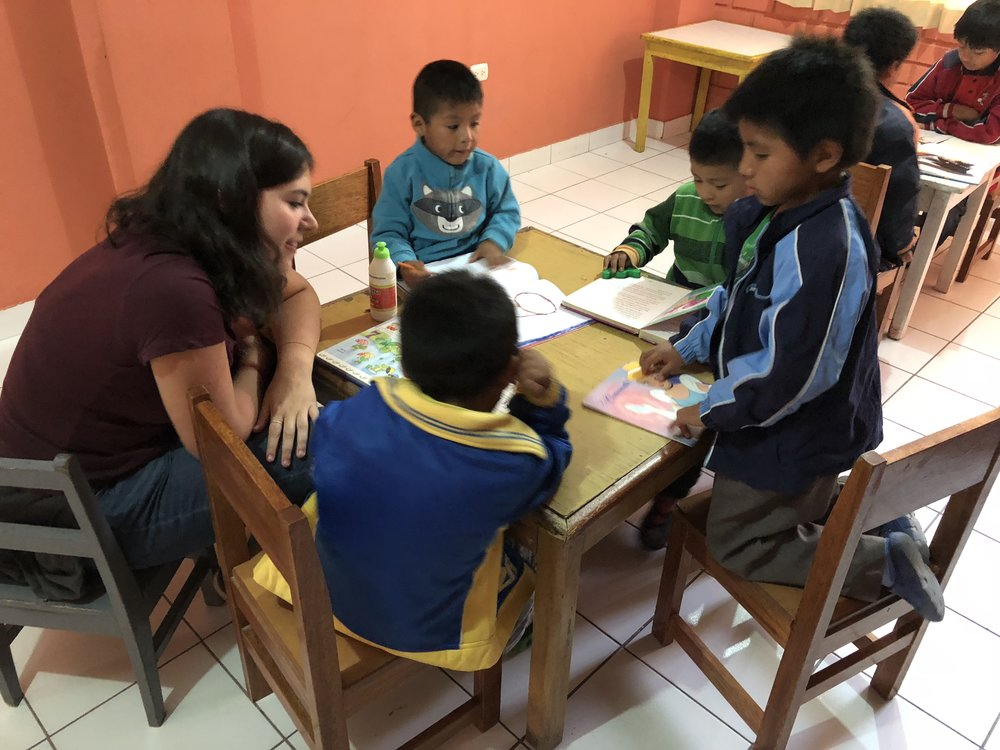 A volunteer with the little ones at the Children's home.