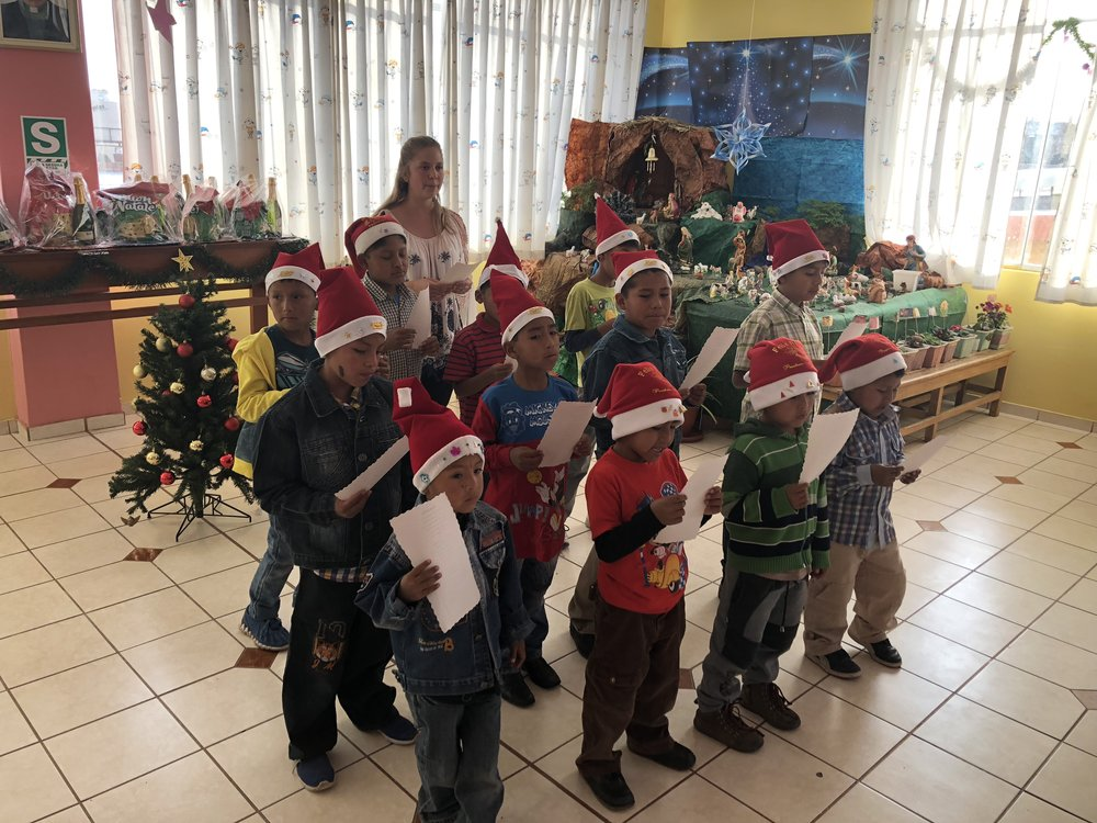The younger children performing at the Children's home