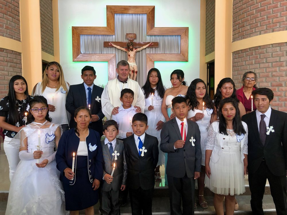 A group of people who received the sacrament of Baptism at St Helen's church at Embajada de Japon settlement.