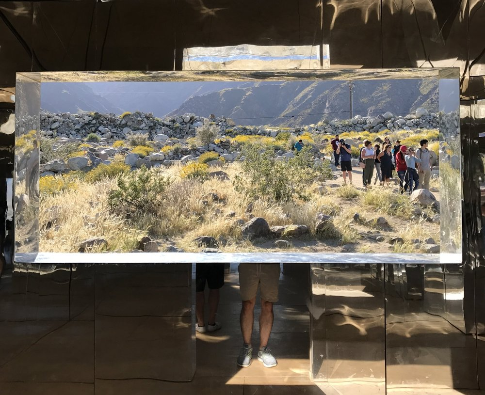 My legs inside Doug Aitken's  Mirage  at DesertX in Palm Springs, CA.