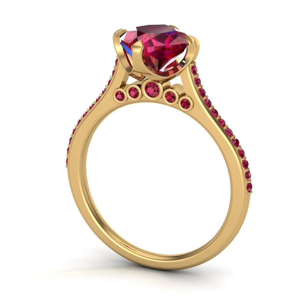Custom ruby solitaire engagement ring, made in 18K yellow gold with a 1.60 ct ruby center stone and 0.20 ctw accent rubies