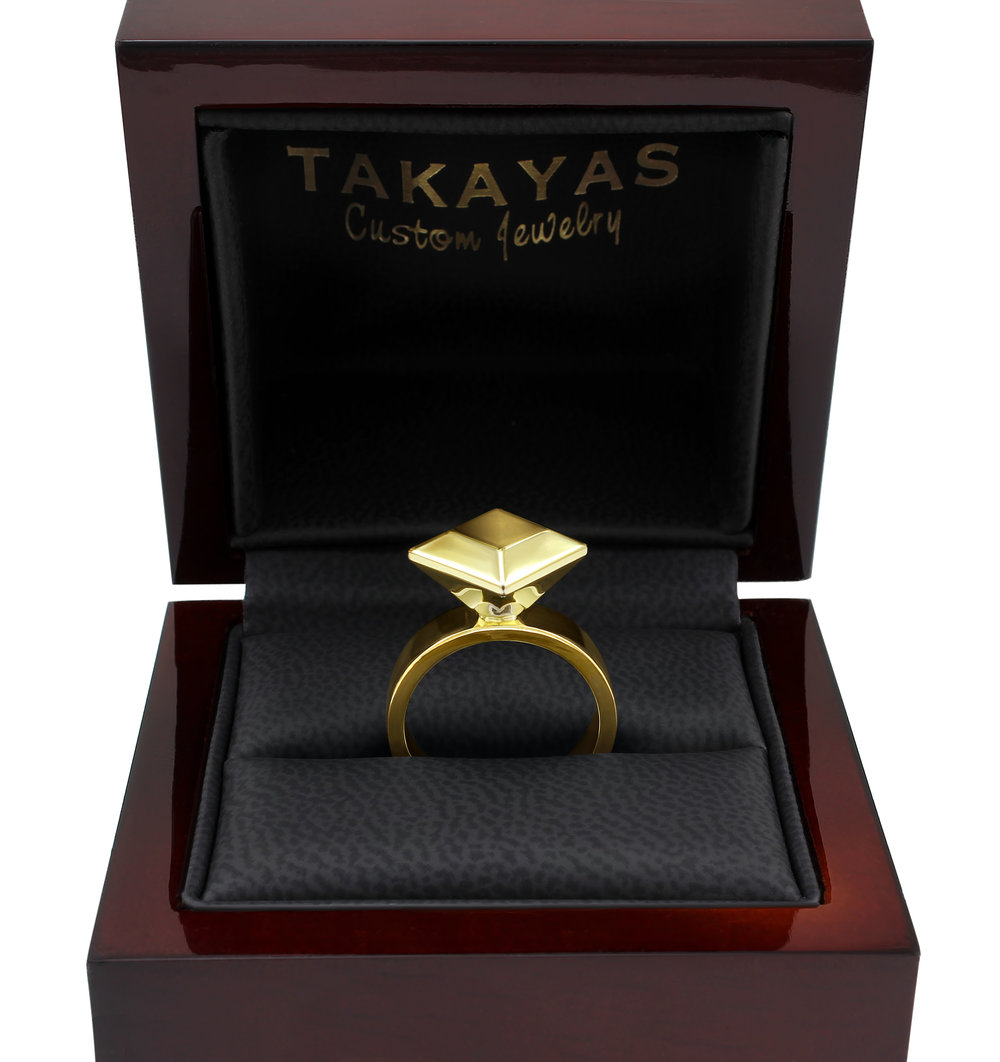 solid-gold-center-stone-ring-takayas.jpg