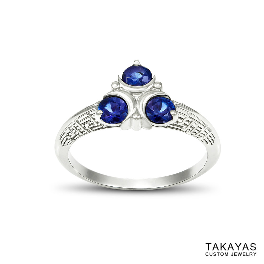 Custom Song of Healing Zora's Sapphire engagement ring with embossed music notes by Takayas Custom Jewelry