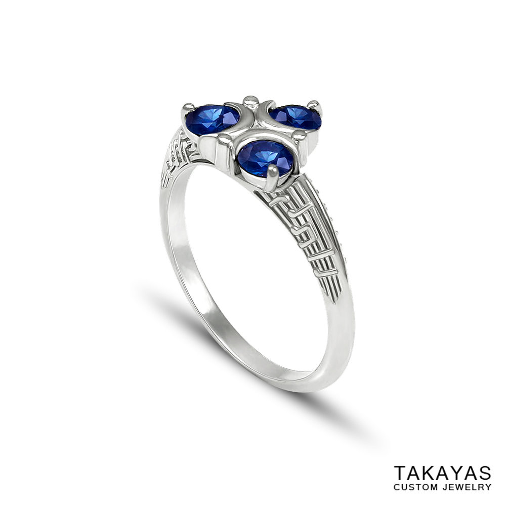 custom Ocarina of Time and Majora's Mask engagement ring by Takayas Custom Jewelry combines Zora's Sapphire with the Song of Healing