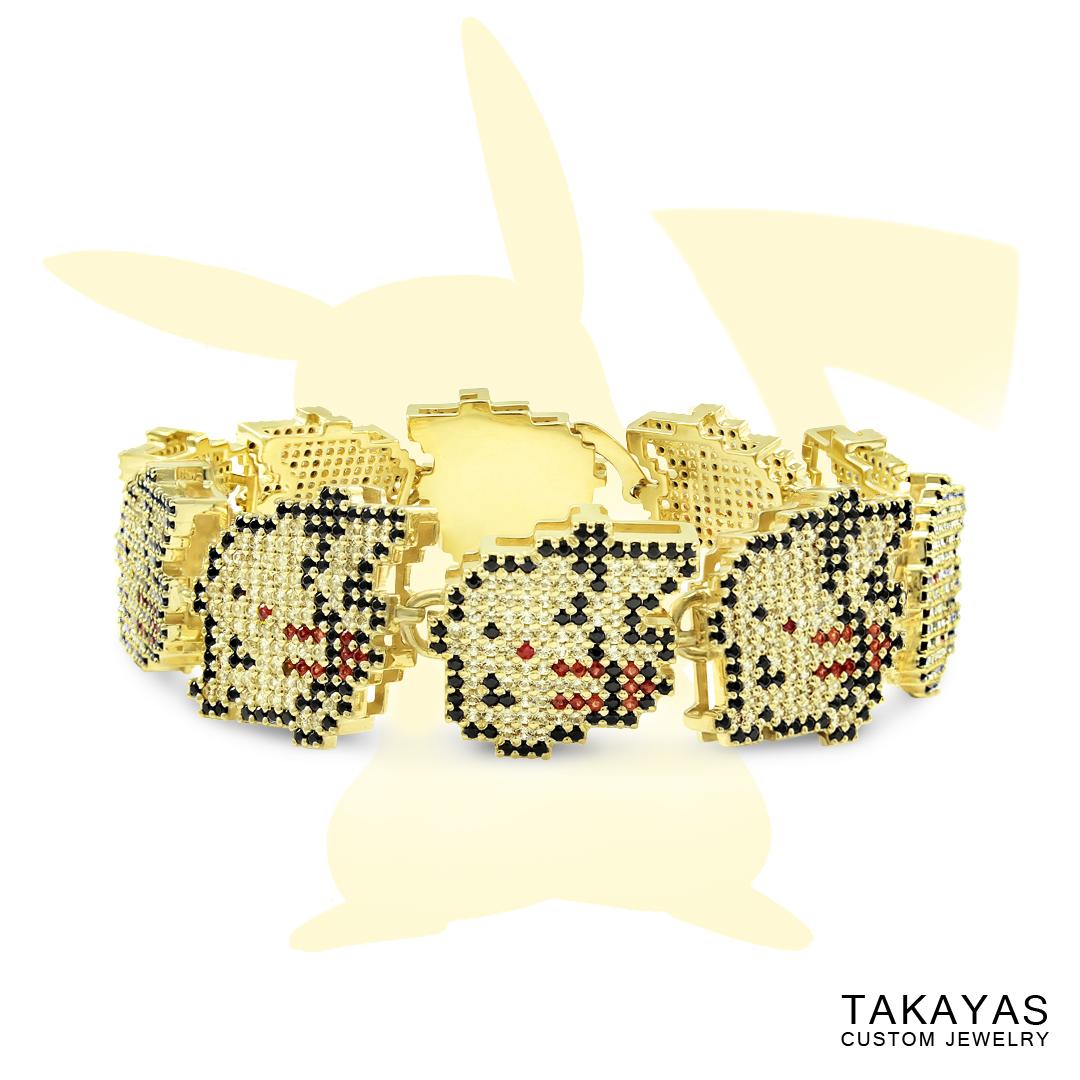 Custom yellow sapphire Pikachu bracelet designed in the pixel art style of Pokemon Yellow