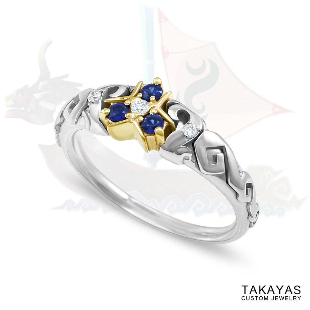 Legend of Zelda inspired Zora's Sapphire engagement ring by Takayas Custom Jewelry features the Windwaker wave pattern on the band