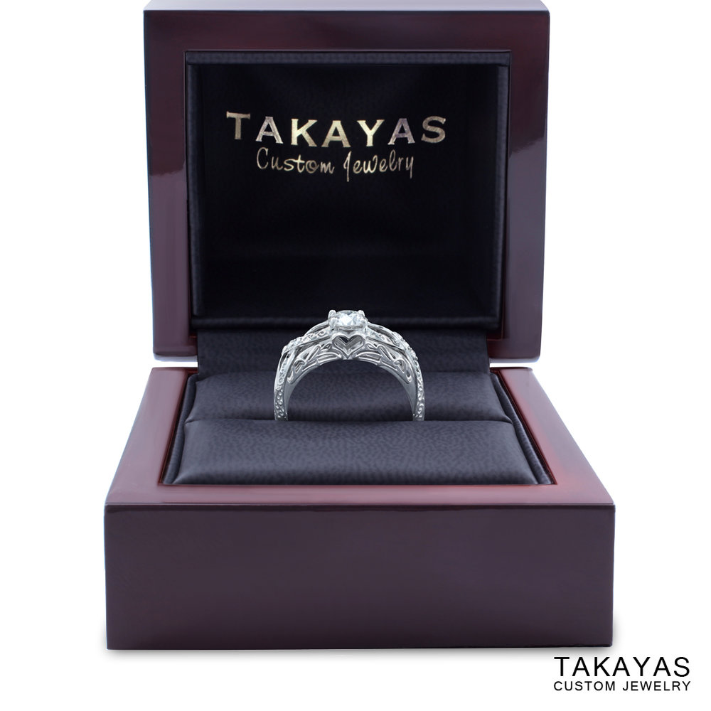 Custom 14K white gold and diamond engagement ring with elegant fantasy elements by Takayas