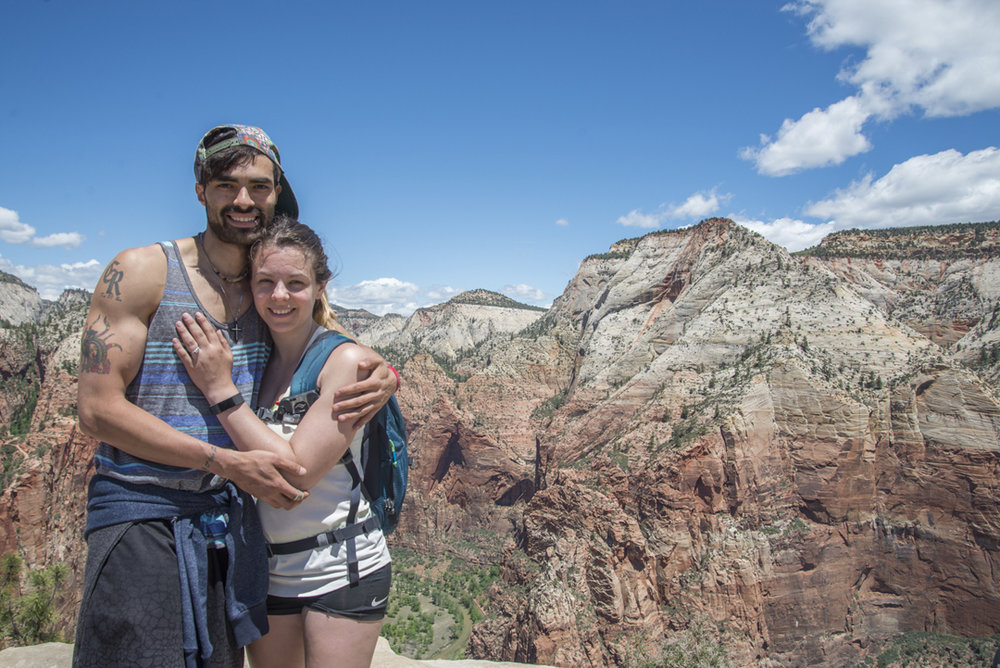 Alexis and Margaret, newly engaged, atop Angels Landing in Zion National Park, with the Celtic Spiderman engagement ring custom made for them by Takayas