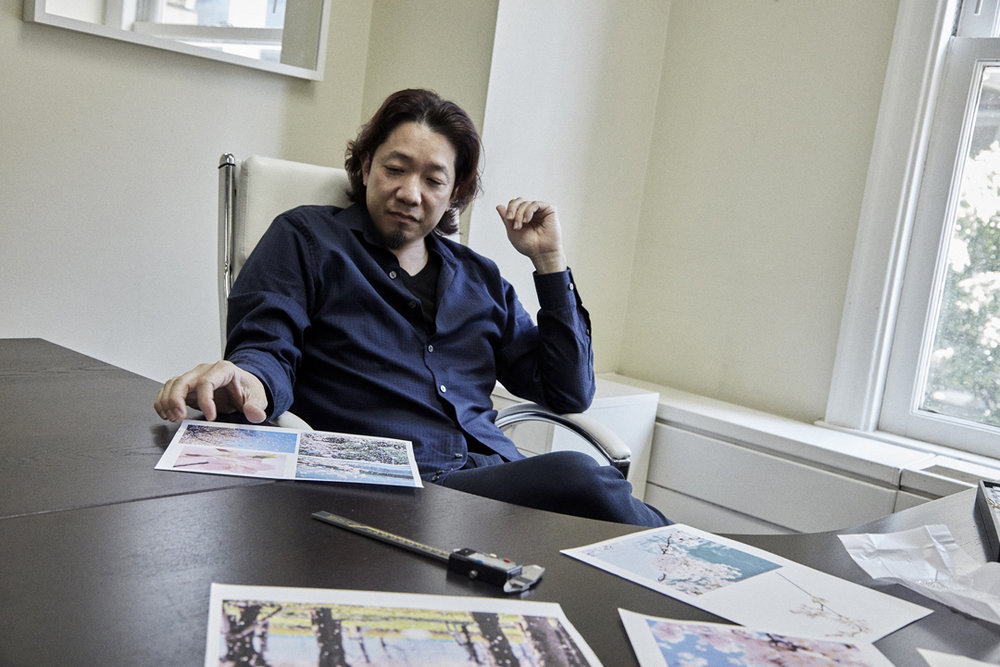 Takayas at his desk, getting inspiration for one of his custom designs - interview by VoyageLA