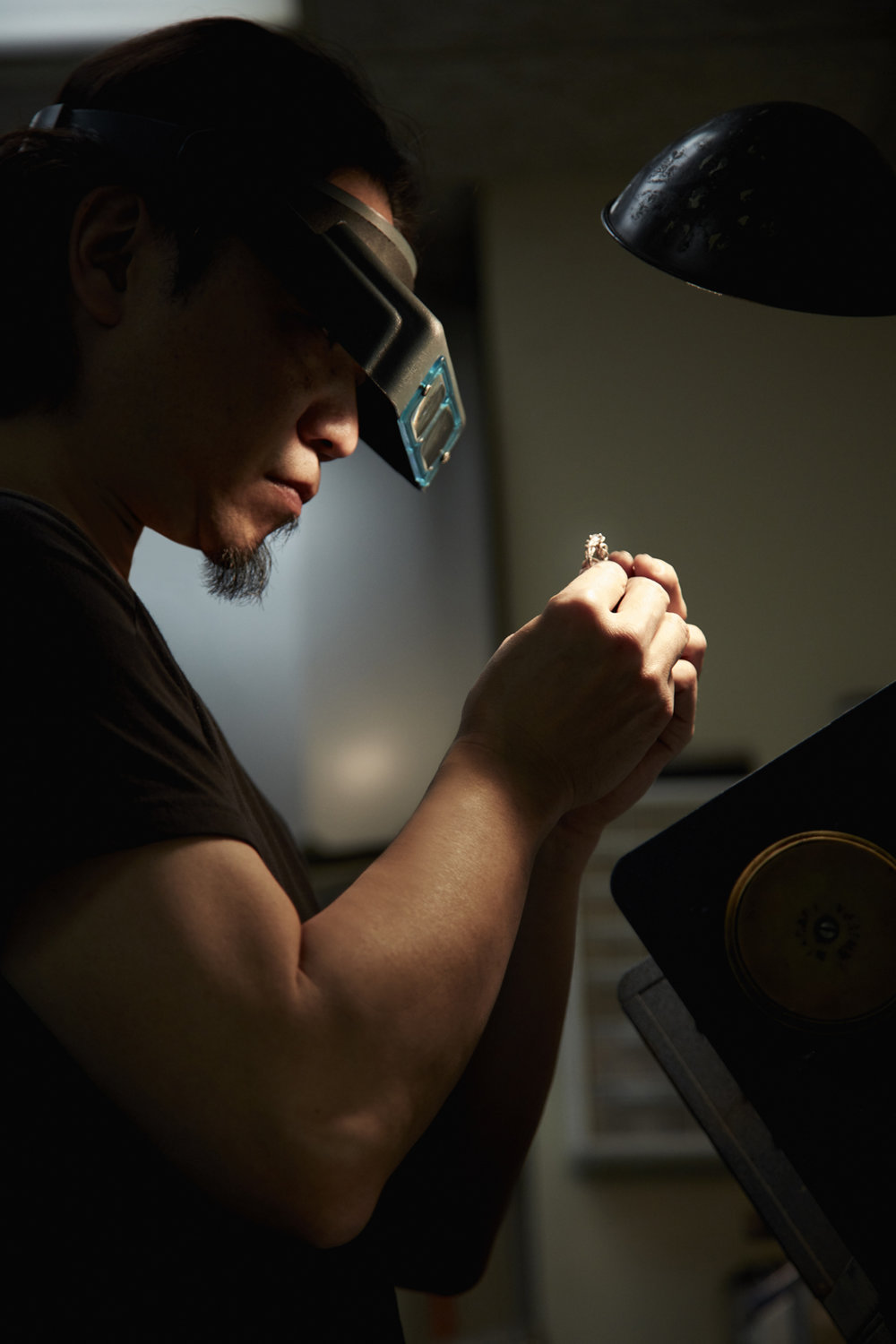 Takayas inspecting one of his rings - VoyageLA interview