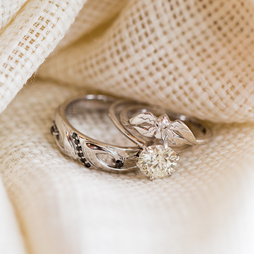 Photograph of Ben & Cassie's White & Black Mage rings by Takayas, on their