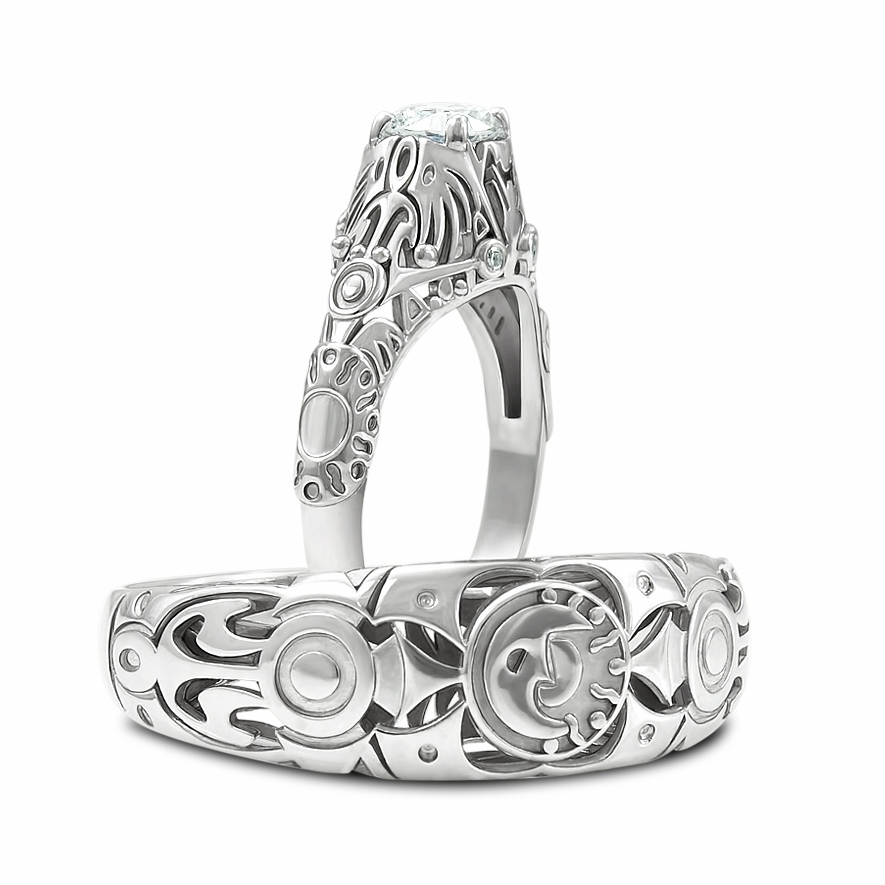 Gallery Image 07:<br />Custom Majora's Mask inspired his and her wedding ring set in 14K white gold with a 0.40 ct round diamond center stone and 0.03 ctw accent diamonds