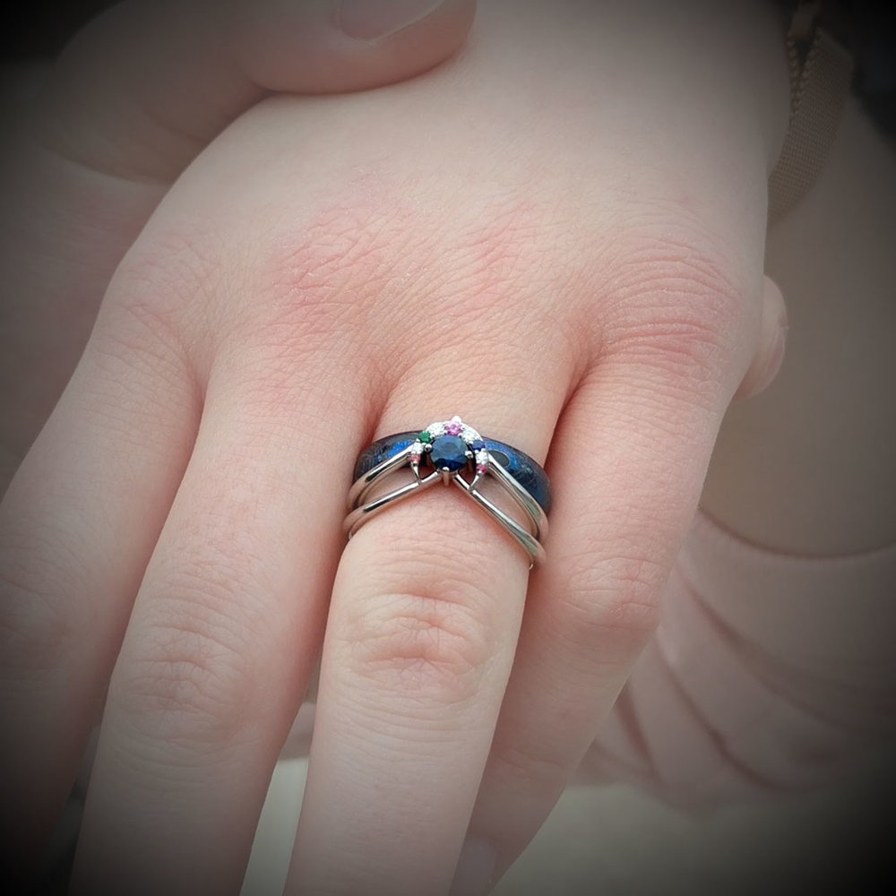 "She said ""Yes!"" The custom Sailor Moon and Doctor Who inspired ring is now at home on Emily's finger."