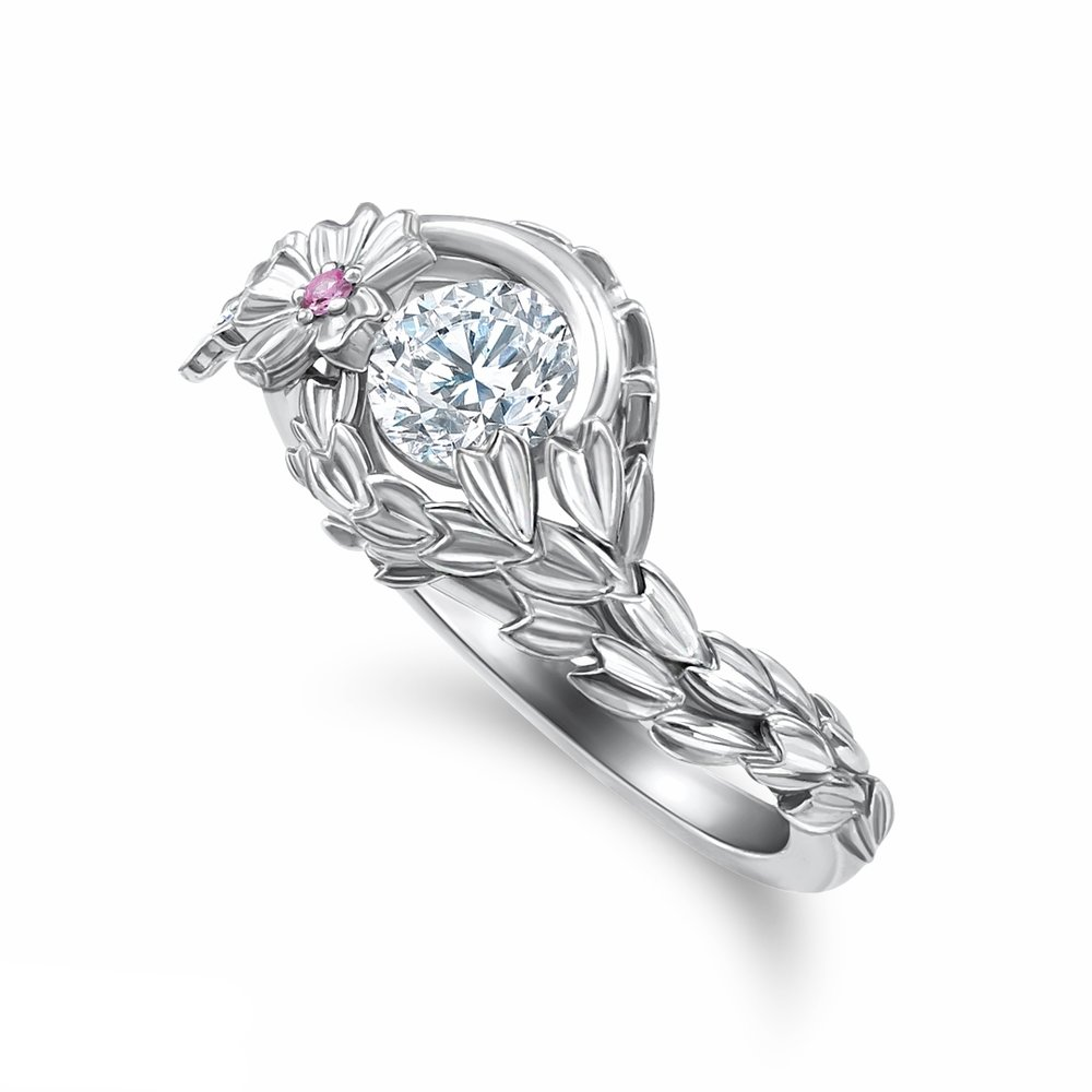 Japanese Cherry Blossom inspired engagement ring in 14K white gold with a few light pink accent sapphires and a 0.51 ct. round brilliant cut diamond center stone
