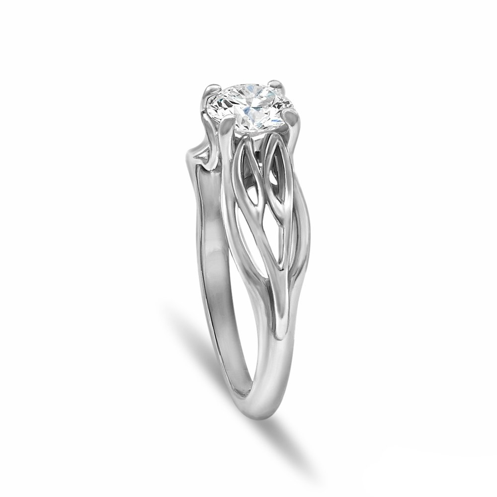 Gallery Image 27:<br />Custom solitaire engagement ring in 14K white gold and a 0.80 ct. round diamond center stone