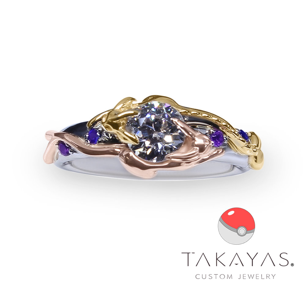 Read more about this Vaporeon and Espeon Pokemon inspired engagement ring on Takayas Custom Jewelry.