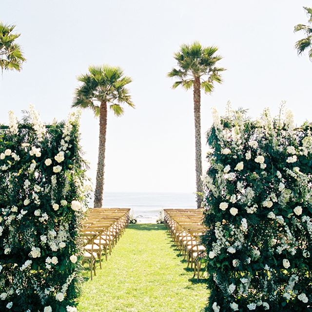 The stunning floral walls by @emmarosefloral framed the ceremony space and welcomed guests to @ranchodospueblos when they stepped off the shuttles. It was a wonderland!  #santabarbarawedding #santabarbaraweddingplanner #dospueblosranchwedding #weddingflowers #floralwall #flowerwall  Planning @donnaromani  Florals @emmarosefloral  Photography @michaelandannacosta  Venue @ranchodospueblos