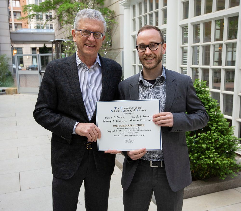 Ben K. D. Pearce (right) and Ralph Pudritz (left) holding the Cozzarelli Prize certificate after the National Academy of Sciences morning awards presentation.
