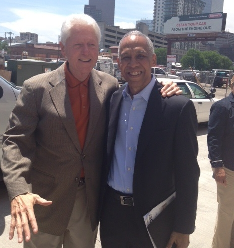 Eric W. Price, CEO of Building America and Executive VP of the HIT, with President Clinton