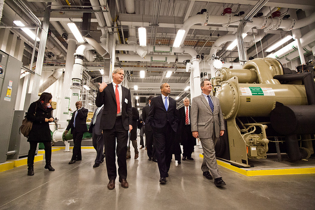 Governor Patrick, center front, tours the computing facility after the ribbon- cutting