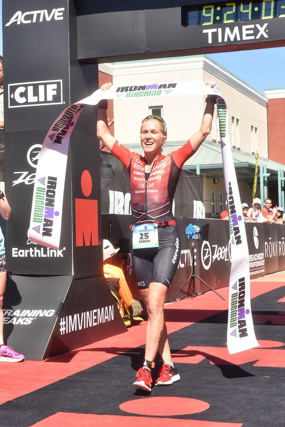 Sarah Piampiano crossing the line to take victory in a course record time at IRONMAN Vineman, 2016.