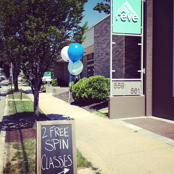 A beautiful day for more balloons on our new chalkboard sign! Come try your first two spin classes for free!