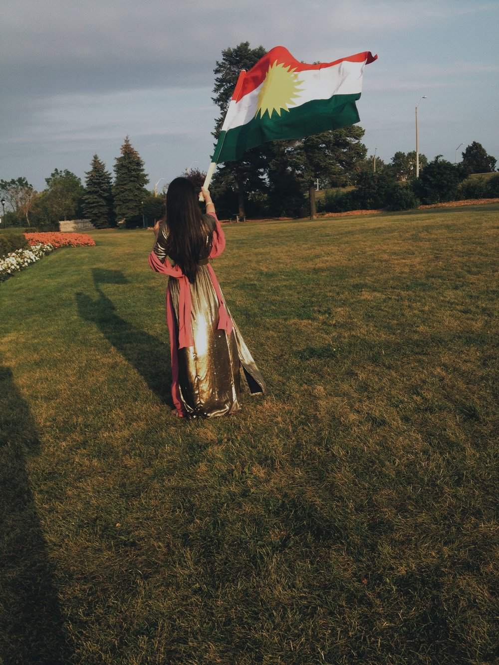 Me with Ala Kurdistanê (The Kurdistan Flag)