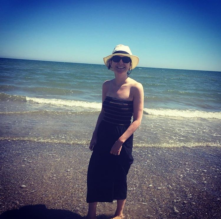 Katie Boylan, chilling on the beach after successful cancer treatment, just like she dreamed she would