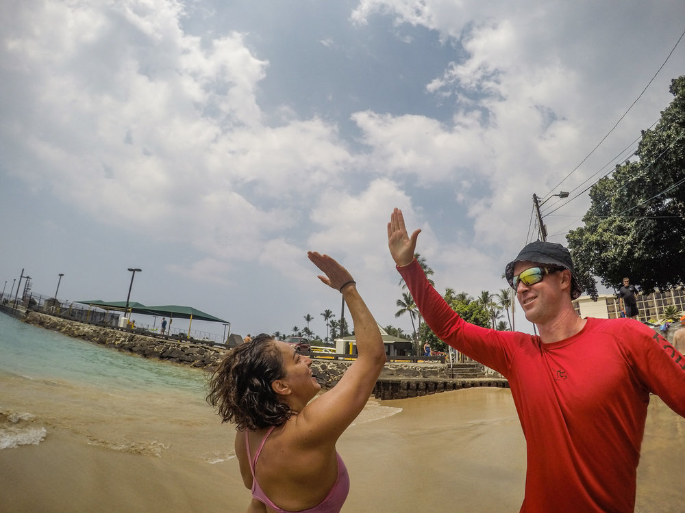 Yafa and McGooks high five at her completion of the iconic swim.