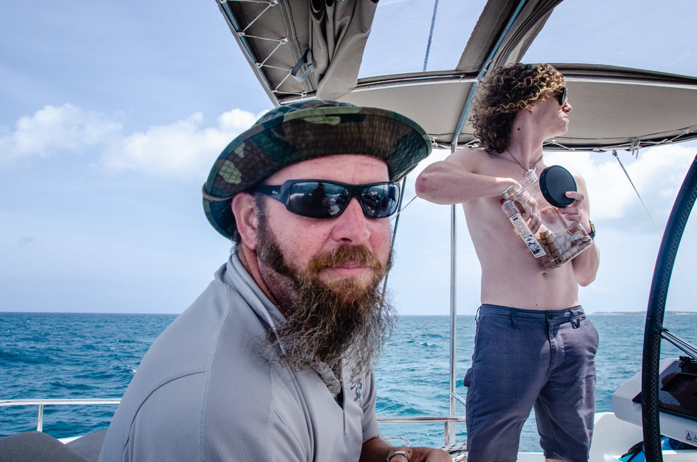 Skipper Richie and First Mate Zack snacking on the bridge as they sail us home.