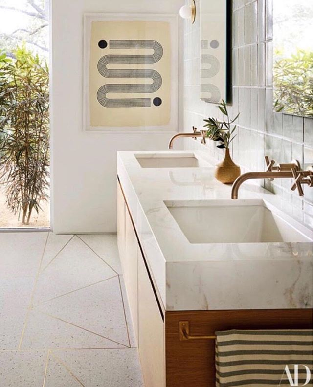 Love this bathroom in @mandymooremm recently remodled home. Cement floors with brass inlays and modern accents 🙌🏻. Designed by the uber talented @sarahshermansamuel . To see more of Mandy Moore's home check out the July issue of @archdigest. . . . . . . . #designdetails #interiordesignmoments  #designisinthedetails #houseandhome #detailsmatter #mondayvibes #mondaymood #currentmood #mondaymotivation #happymonday #motivationmonday #interiorinspiration  #OCInteriorDesigner #OrangeCountyHomes #OCHomes #Interior123 #CurrentSituation #designideas  #designinspiration #designoftheday  #bathroomdesign #bathroomdecor #bathroominterior  #inspire_me_home_decor #interiorandhome #bathroominspiration #bath_rooms_of_insta #bathroomsofinstagram #bathroomgoals #bathroomremodel