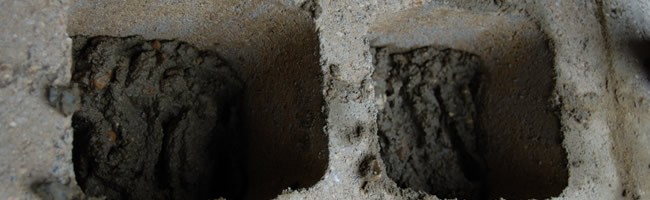 Grout or block fill... - A mixture of sand, cement and water. Grout is the material for filling voids in concrete blocks and slabs.