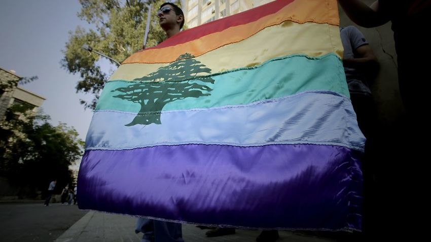A gay pride flag is carried by human rights activists during an anti-homophobia rally in Beirut on April 30, 2013. Source: AFP