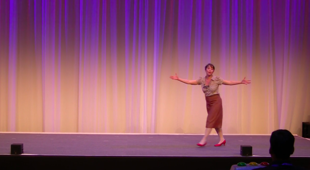 Dyane Neiman animates ca. 500 people at the International Toastmasters District Conference in Berlin, May 2017