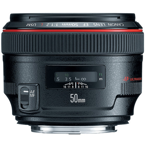 Canon 50mm f/1.2 USM Lens - I could shoot the entire wedding with this lens; portraits to details to family photos. I use this lens in a majority of your romantic portraits together. It is clear, quick, and just what I need to capture the love between the two of you.