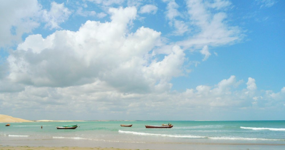Boats near sand dunes of Jericoacoara