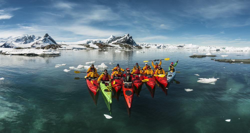 Kayaking through Ice Glaciers in Antarctica