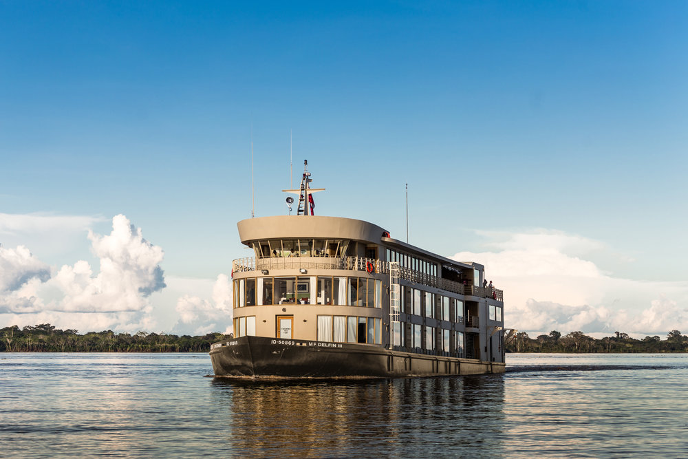 Delfin III sailing down the Amazon River, Peru