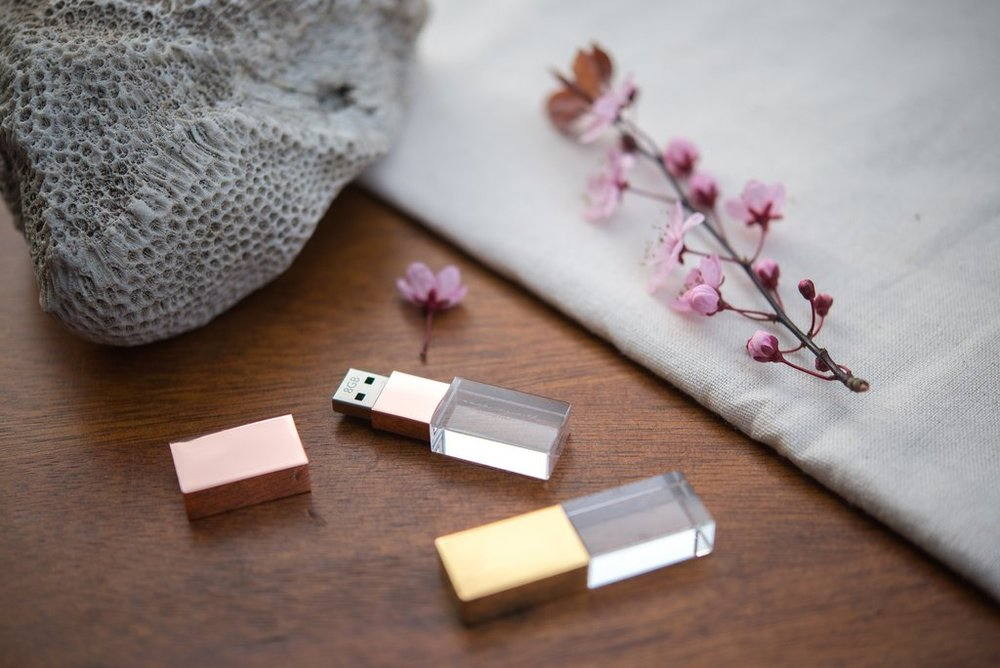 Custom USBs - Preserve your digital files on a customized crystal glass USB flash drive. Available in silver, gold, and rose gold.Linen keepsake boxes are also available for storage and protection of your USB flash drive.