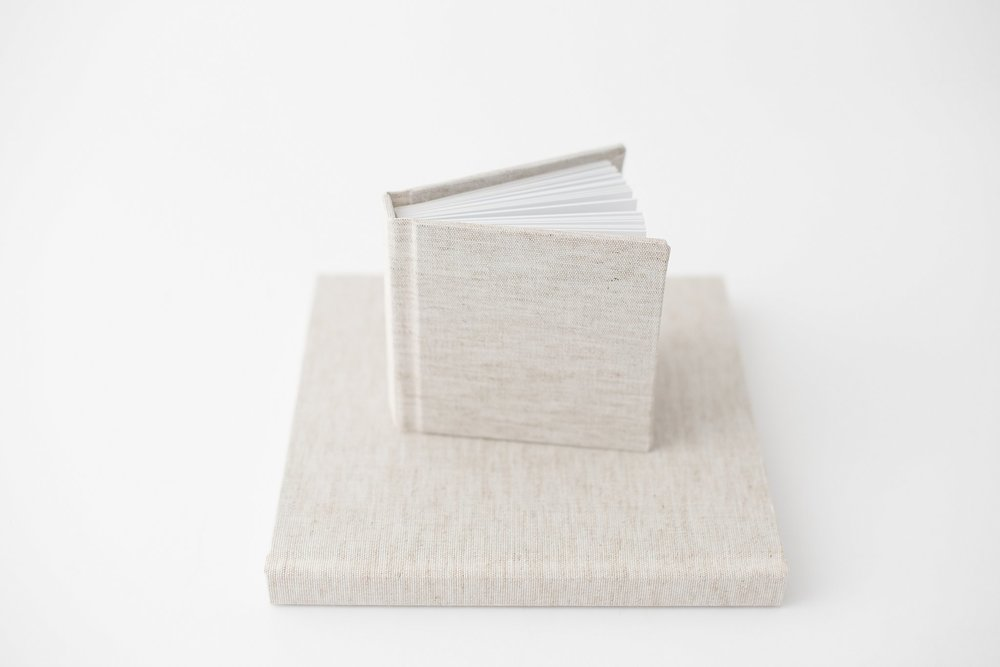 Our 4x4 mini album featured with an 8x8, luxe linen album