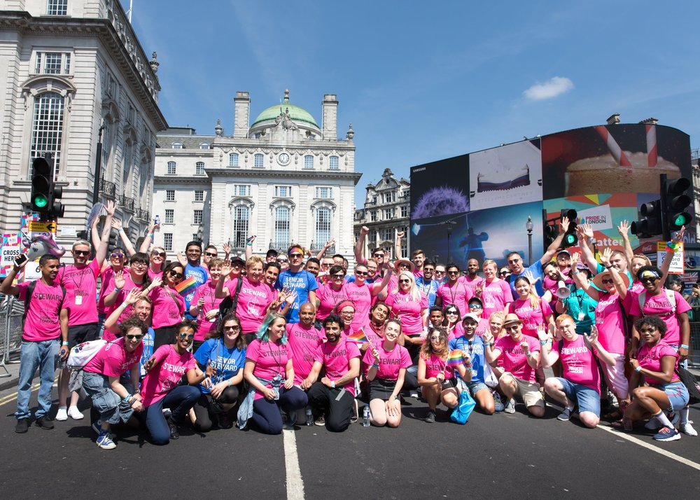 LONDON, ENGLAND - JULY 07: Group shot of volunteer stewards before the opening of Pride In London 2018 at Picadilly Circus. Pride In London is the UK's biggest, most diverse Pride which provides a platform for every part of London's LGBT+ community (lesbian, gay, bisexual, trans*, queer, questioning, intersex, non-binary, asexual, polysexual, genderqueer and gender variant people) to raise awareness of LGBT+ issues and campaign for the freedoms that will allow them to live their lives on a genuinely equal footing on July 7, 2018 in London, England. (Photo by Carol J Moir/Pride In London)