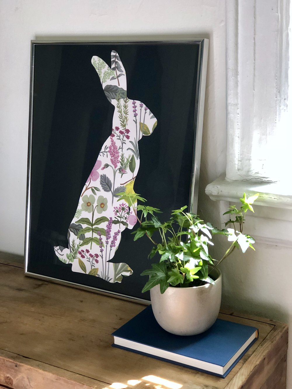 Easy Spring DIY's EASTER FLORAL BUNNY ART MATERIALS: Printed google bunny silhouette, Floral paper, Double sided tape, Black poster board
