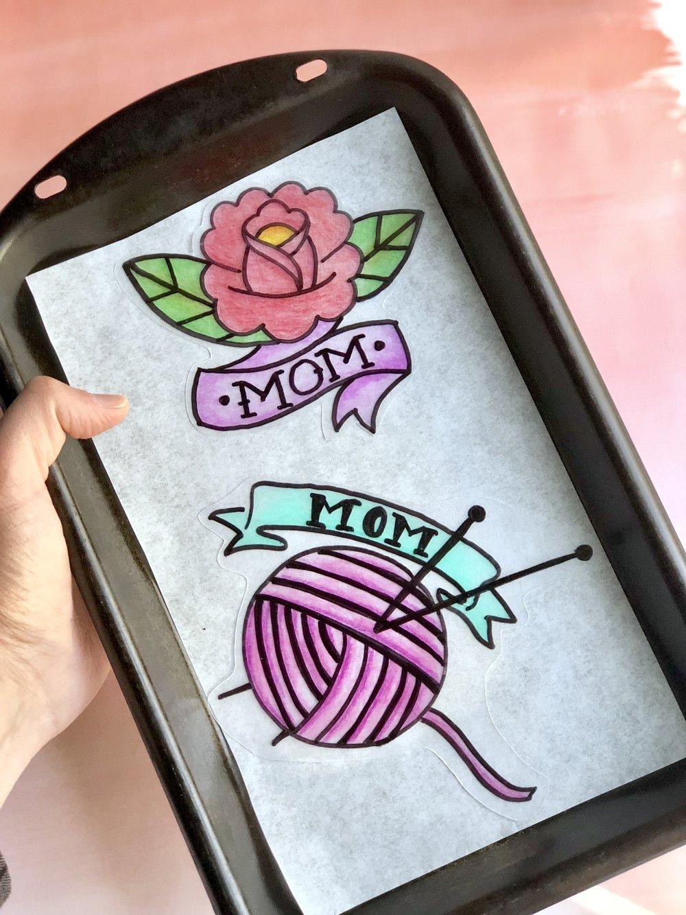 Mother's Day Shrinky Dink Mom Tattoo Pins #mothersdaydiy #mothersdaygifts #shirnkydinks #shrinkydink #shrinkydinkideas #diypin #diybrooch #momtatto #momsday #handmadegifts #giftsformom #giftsforher #badassmom #craftymom #badasswomen #womansrights #futureisfemale