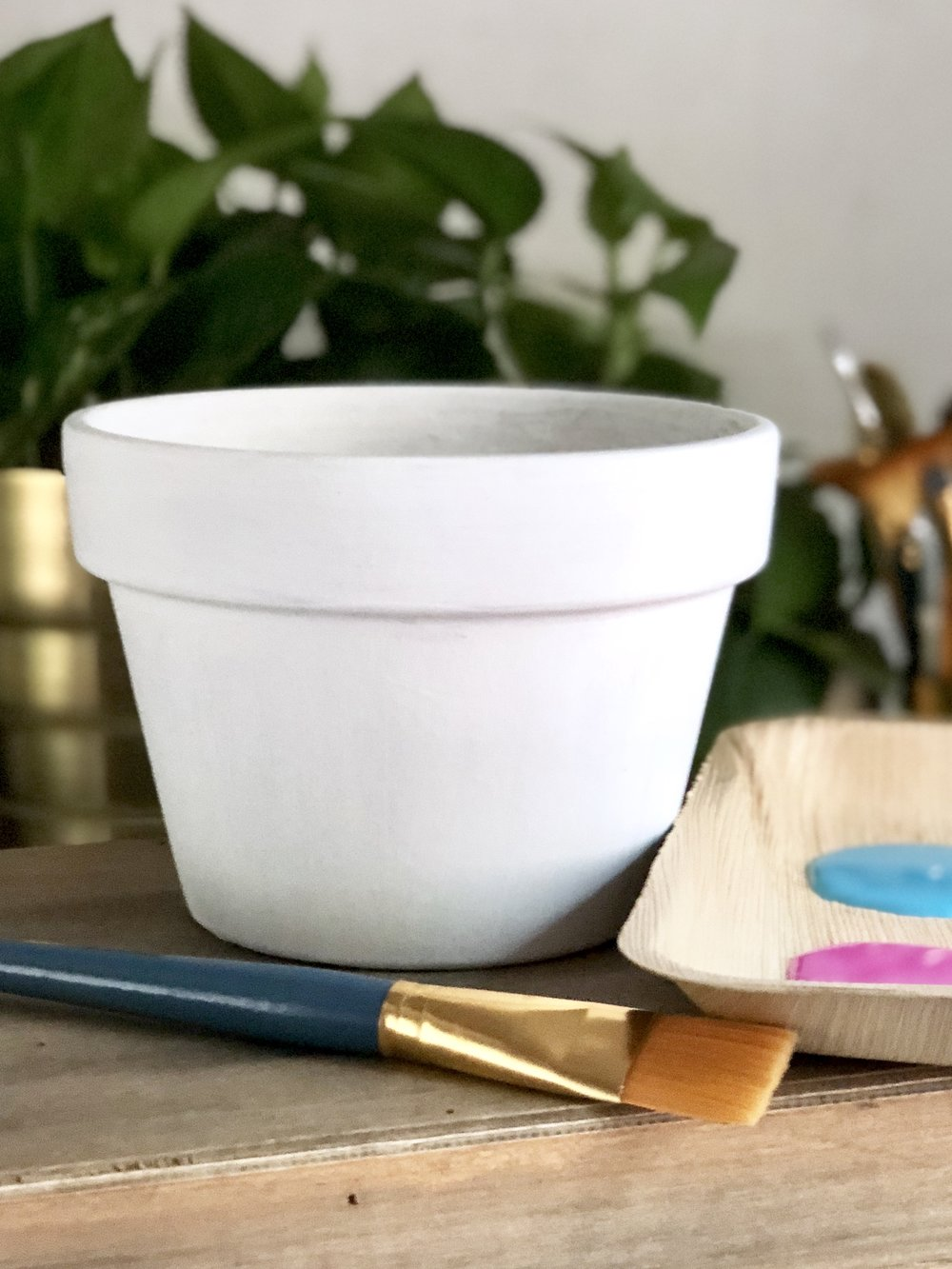 Make a funky pot with a colorful layered painting technique!