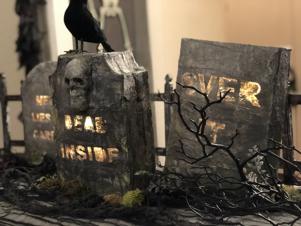 DIY sarcastic hidden message tombstones made out of cereal boxes, plaster bandage strips and paint.