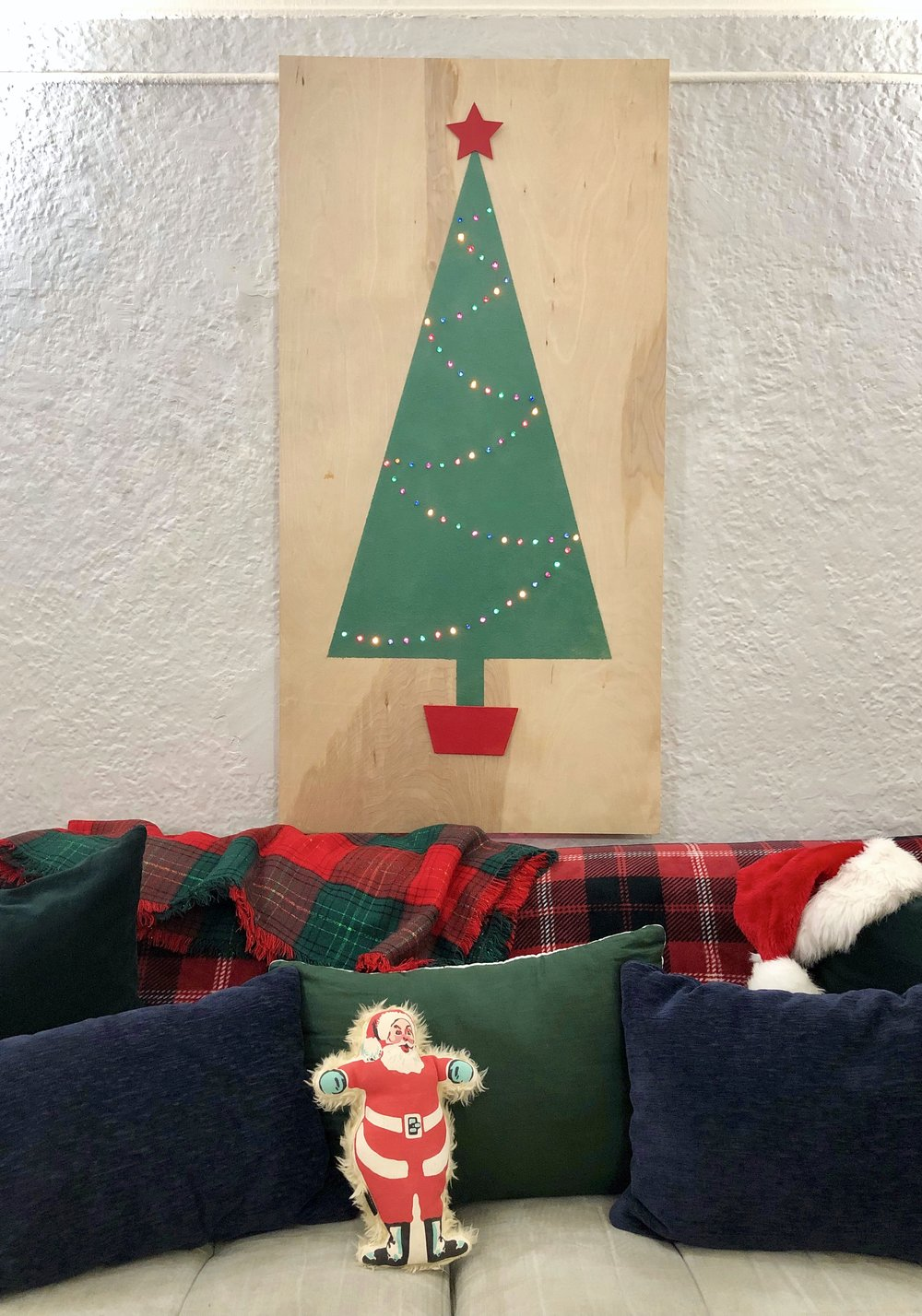 Retro inspired flocked Christmas tree on a piece of plywood. Great for decorating small spaces
