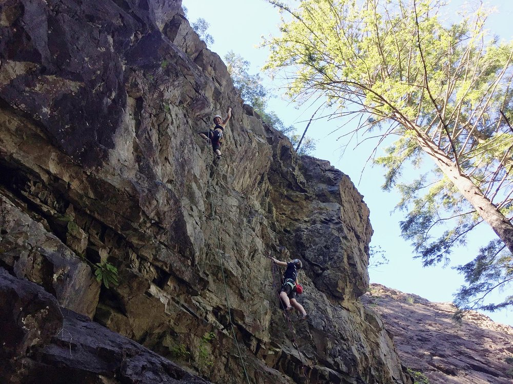 The ladies practicing taking lead falls on an overhanging wall at Exit 38.