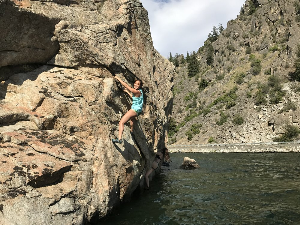 Felecia hanging over a deep water soloing route in Banks Lake Washington!