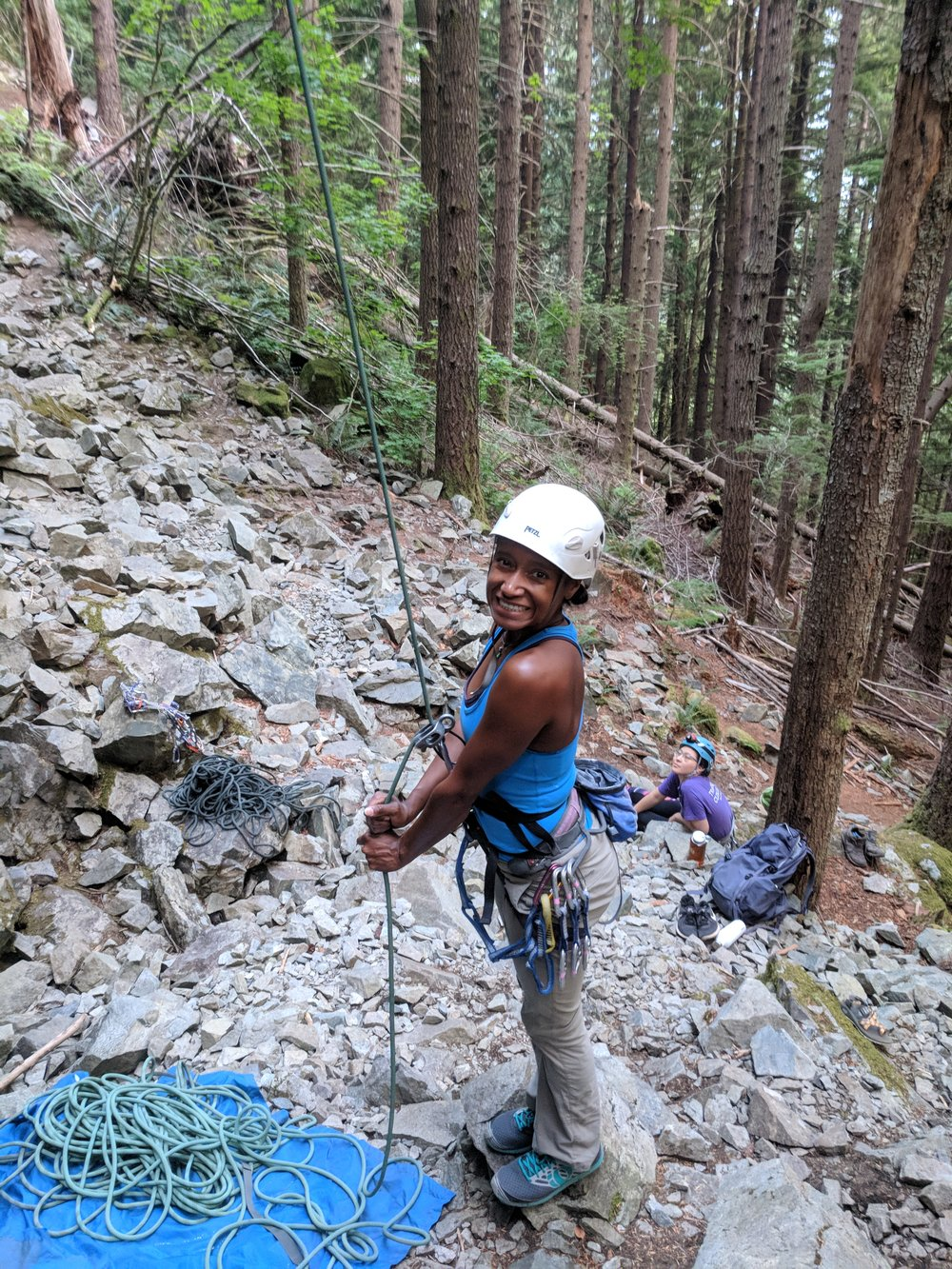 Alina Tennie belaying at the Motherland climbing area at Exit 38 during the Never Stop Moving Exit 38 Climbing Series.