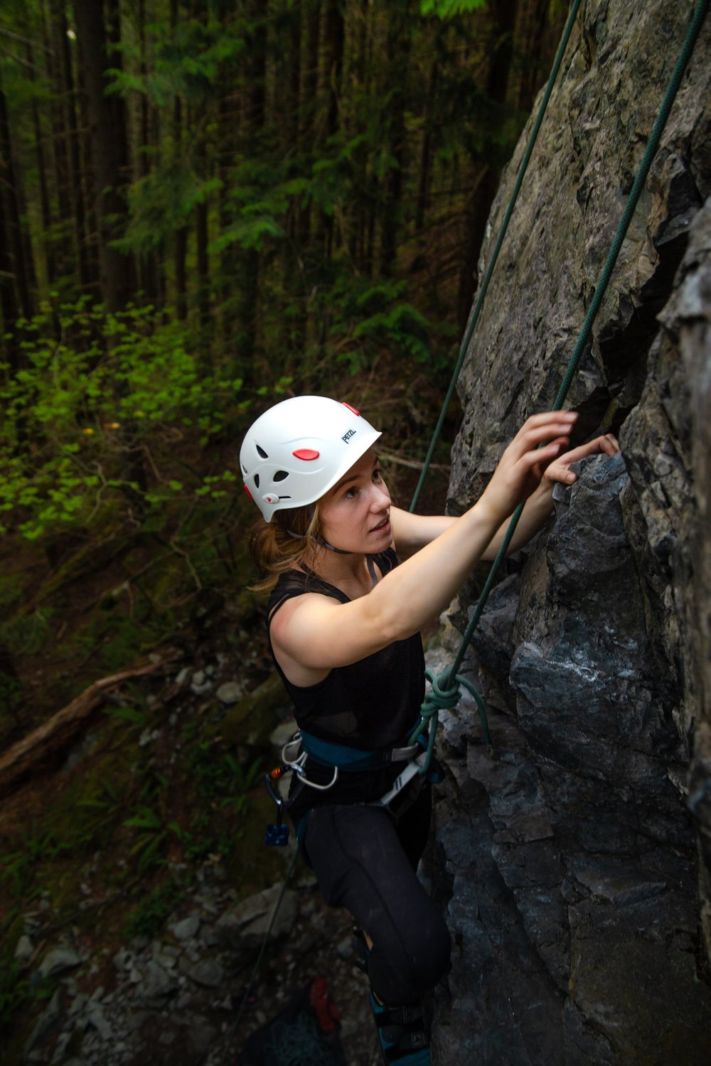 Danielle Seymour climbing at The Motherland climbing area during the Never Stop Moving Exit 38 Climbing Series.  Photo Credit:   Heather Dubrall Photography  [ photo cropped ]